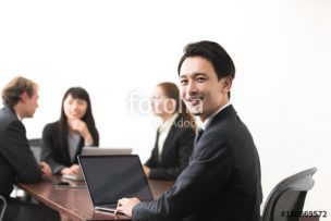 Businessman in meeting room.